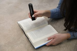 OrCam Read with a book