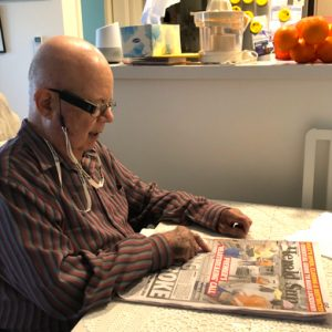 s reading the daily paper